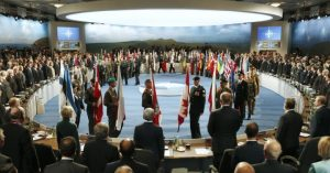 leaders-watch-their-flags-they-participate-nato-summit-session-one