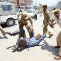 Indian-police-men-beating-a-Kashmiri-during-a-protest-against-illegal-occupation.
